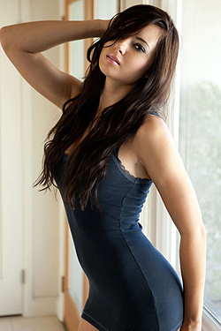 Natasha Belle Taking Off Her Dress